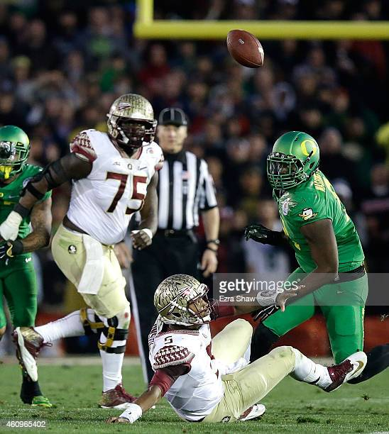 Quarterback Jameis Winston of the Florida State Seminoles fumbles the ball in the third quarter of the College Football Playoff Semifinal at the Rose...