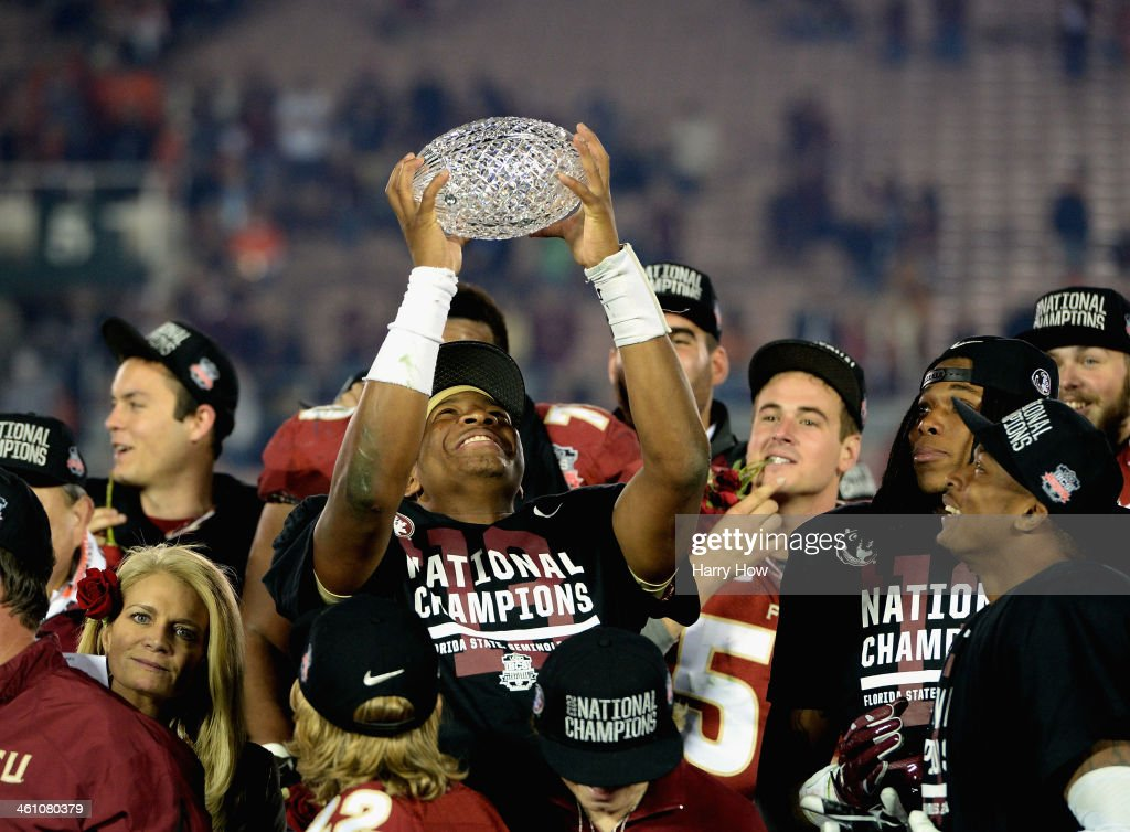 Quarterback Jameis Winston #5 of the Florida State Seminoles holds the Coaches' Trophy after defeating the Auburn Tigers 34-31 in the 2014 Vizio BCS National Championship Game at the Rose Bowl on January 6, 2014 in Pasadena, California.