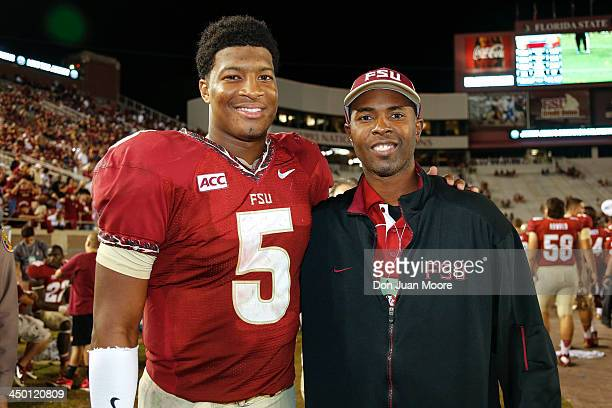 Quarterback Jameis Winston of the Florida State Seminoles poses with former Florida State quarterback and Heisman Trophy winner Charlie Ward after...