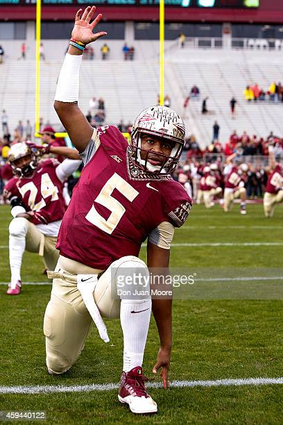 Quarterback Jameis Winston of the Florida State Seminoles warming up before the game against the Boston College Eagles at Doak Campbell Stadium on...