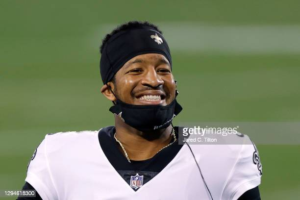 Quarterback Jameis Winston of the New Orleans Saints shares a smile during the second half of their game against the Carolina Panthers at Bank of...