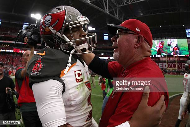 Quarterback Jameis Winston of the Tampa Bay Buccaneers and head coach Bruce Arians of the Arizona Cardinals shake hands following the 407 NFL game at...