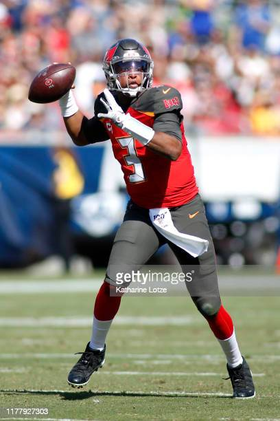 Quarterback Jameis Winston of the Tampa Bay Buccaneers drops back to pass the ball during the second quarter against the Los Angeles Rams at Los...