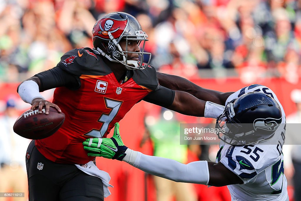 Quarterback Jameis Winston #3 of the Tampa Bay Buccaneers gives Defensive End Frank Clark #55 a stiff arm during the game against the Seattle Seahawks at Raymond James Stadium on November 27, 2016 in Tampa, Florida. The Bucs defeated the Seahawks 14 to 5.