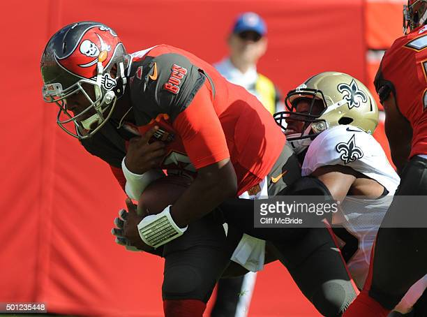 Quarterback Jameis Winston of the Tampa Bay Buccaneers is sacked by defensive end Obum Gwacham of the New Orleans Saints in the first quarter at...