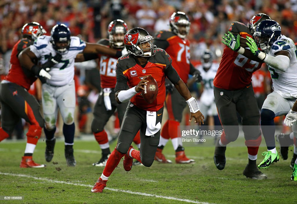 Quarterback Jameis Winston #3 of the Tampa Bay Buccaneers looks for a receiver during the third quarter of an NFL game against the Seattle Seahawks on November 27, 2016 at Raymond James Stadium in Tampa, Florida.