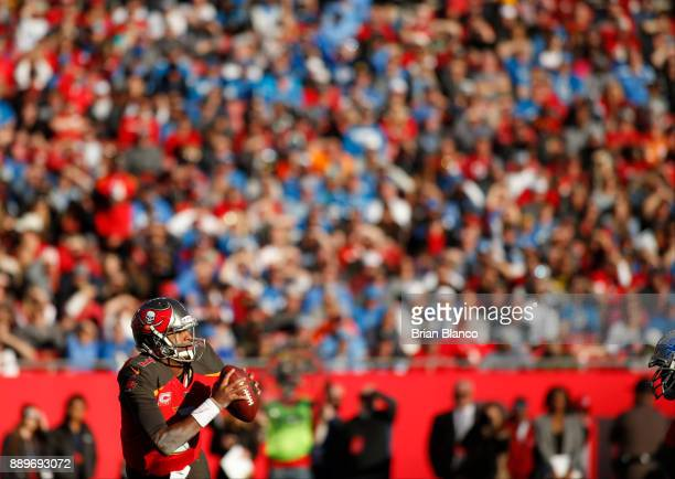 Quarterback Jameis Winston of the Tampa Bay Buccaneers looks for an open receiver during the fourth quarter of an NFL football game against the...
