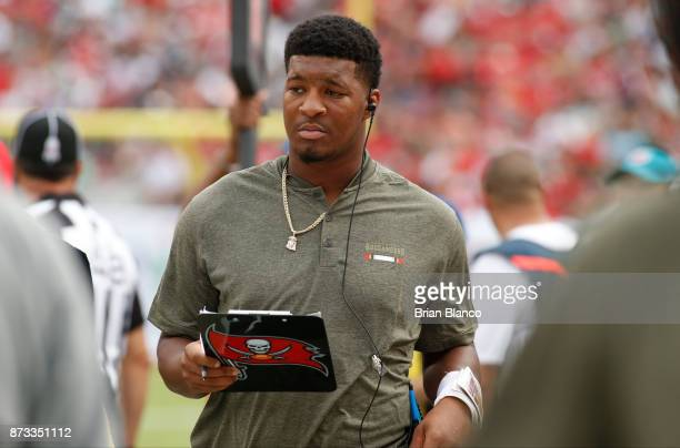 Quarterback Jameis Winston of the Tampa Bay Buccaneers looks over his clipboard on the sidelines during the third quarter of an NFL football game...