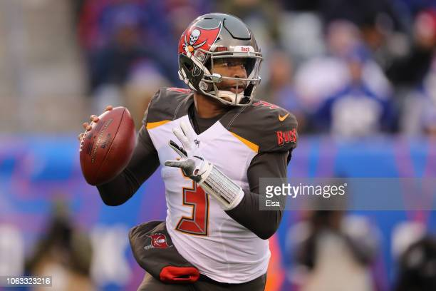 Quarterback Jameis Winston of the Tampa Bay Buccaneers looks to pass against the New York Giants during the fourth quarter at MetLife Stadium on...