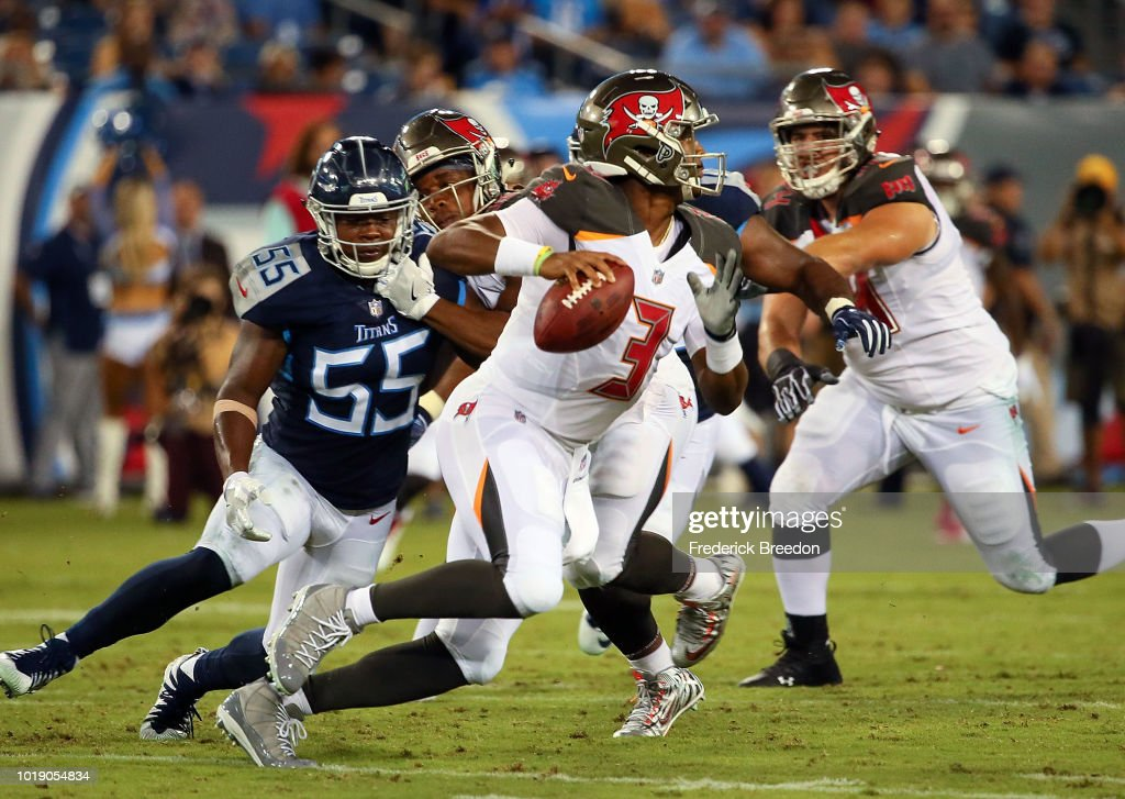 Quarterback Jameis Winston #3 of the Tampa Bay Buccaneers rolls away from Jayon Brown #55 of the Tennessee Titans during the first half of a pre-season game at Nissan Stadium on August 18, 2018 in Nashville, Tennessee.