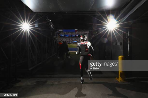 Quarterback Jameis Winston of the Tampa Bay Buccaneers runs out onto the field before playing against the New York Giants at MetLife Stadium on...