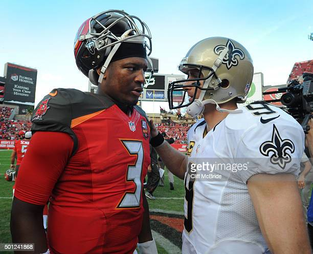 Quarterback Jameis Winston of the Tampa Bay Buccaneers talks with quarterback Drew Brees of the New Orleans Saints after the game at Raymond James...