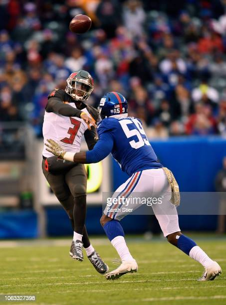 Quarterback Jameis Winston of the Tampa Bay Buccaneers throws a pass against linebacker Lorenzo Carter of the New York Giants during the fourth...