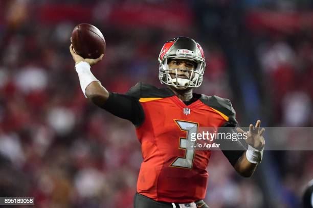 Quarterback Jameis Winston of the Tampa Bay Buccaneers throws a touchdown pass in the fourth quarter against the Atlanta Falcons on December 18 2017...