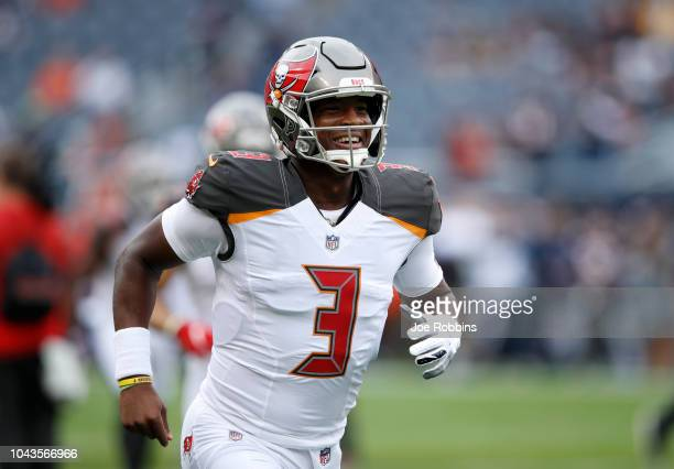 Quarterback Jameis Winston of the Tampa Bay Buccaneers warms up prior to the game against the Chicago Bears at Soldier Field on September 30 2018 in...