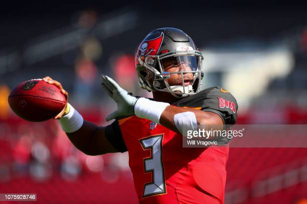 Quarterback Jameis Winston of the Tampa Bay Buccaneers warms up before the game against the Atlanta Falcons at Raymond James Stadium on December 30...