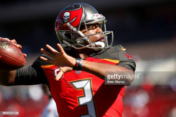 Quarterback Jameis Winston of the Tampa Bay Buccaneers warms up before the start of an NFL football game against the Detroit Lions on December 10...