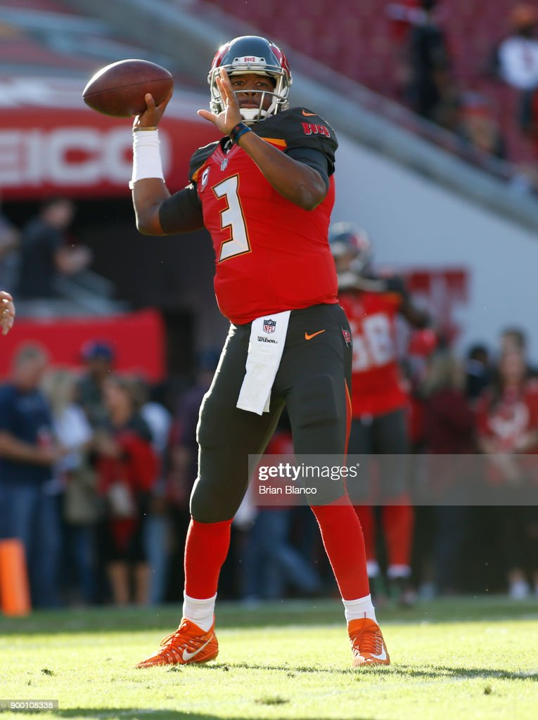 Quarterback Jameis Winston #3 of the Tampa Bay Buccaneers warms up before the start of an NFL football game against the New Orleans Saints on December 31, 2017 at Raymond James Stadium in Tampa, Florida.