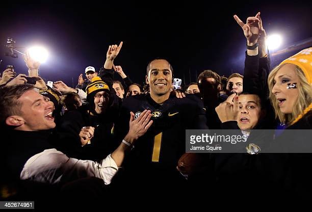 Quarterback James Franklin of the Missouri Tigers is swarmed by fans after the Tigers defeated the Texas A&M Aggies 28-21 to win the game on November...