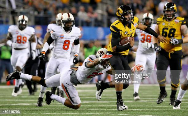 Quarterback James Franklin of the Missouri Tigers runs the ball for 16-yards against Lyndell Johnson of the Oklahoma State Cowboys in the second...