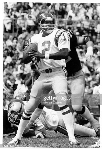 Quarterback James Harris of the San Diego Chargers drops back to pass against the Oakland Raiders at OaklandAlameda County Coliseum on September 18...