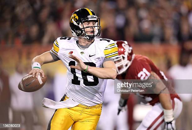 Quarterback James Vandenberg of the Iowa Hawkeyes drops back to pass during the Insight Bowl against the Oklahoma Sooners at Sun Devil Stadium on...