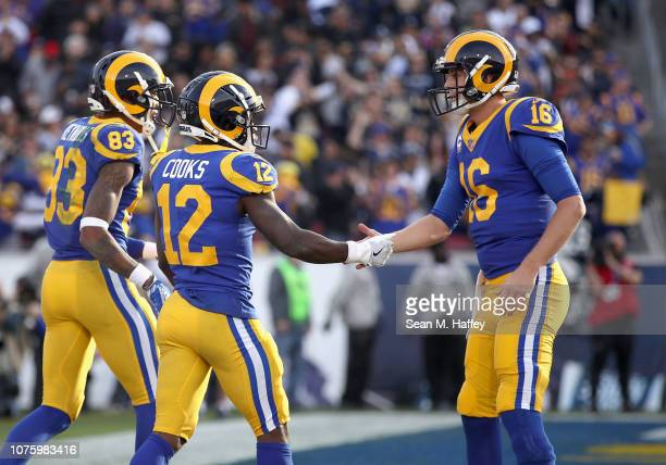 quarterback Jared Goff congratulates Los Angeles Rams wide receiver Brandin Cooks after his rushing touchdown during the first half of a game against...