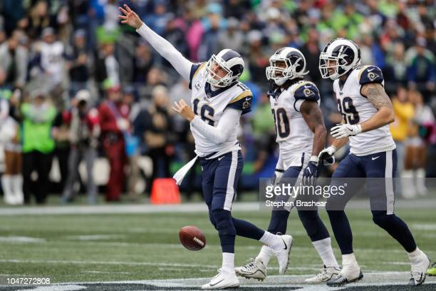 Quarterback Jared Goff of the Los Angeles Rams celebrates a first down in the fourth quarter against the Seattle Seahawks at CenturyLink Field on...