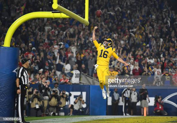 Quarterback Jared Goff of the Los Angeles Rams celebrates his touchdown on a seven yard rush by dunking the football between the goal posts during...