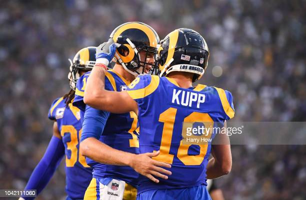 Quarterback Jared Goff of the Los Angeles Rams celebrates his touchdown with wide receiver Cooper Kupp to take a 2117 lead in the second quarter...