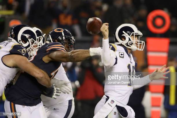 Quarterback Jared Goff of the Los Angeles Rams gets the football stripped by Khalil Mack of the Chicago Bears in the third quarter at Soldier Field...
