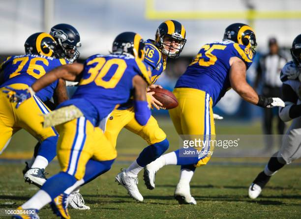 Quarterback Jared Goff of the Los Angeles Rams looks to hand off during the game against the Seattle Seahawks at Los Angeles Memorial Coliseum on...