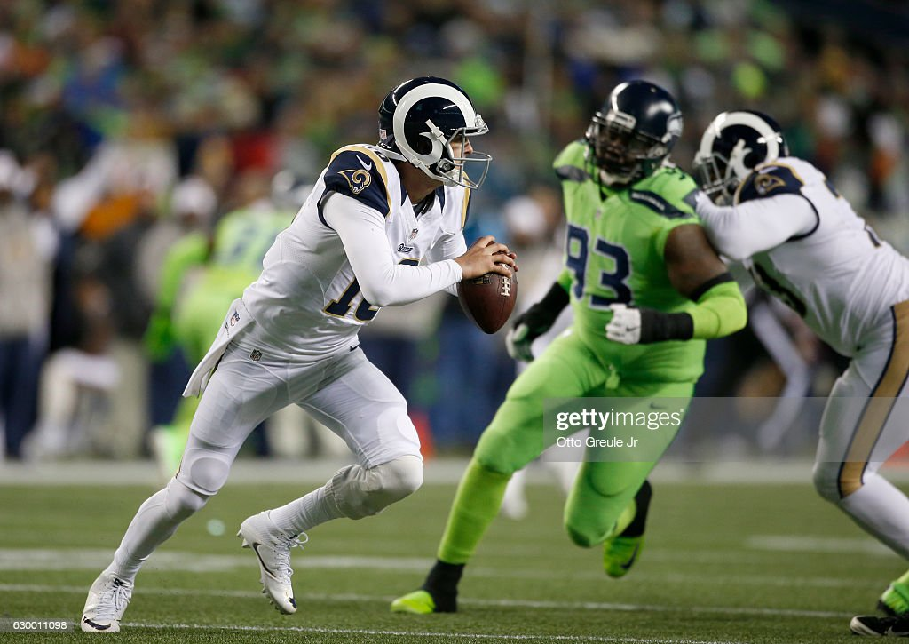 Quarterback Jared Goff #16 of the Los Angeles Rams looks to pass against the Seattle Seahawks at CenturyLink Field on December 15, 2016 in Seattle, Washington.