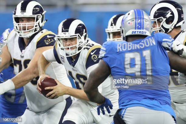 Quarterback Jared Goff of the Los Angeles Rams looks to run the ball against A'Shawn Robinson of the Detroit Lions during the second half at Ford...