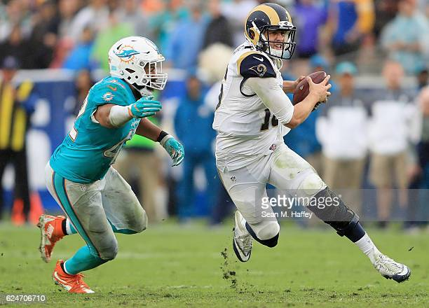 Quarterback Jared Goff of the Los Angeles Rams runs with the ball away from Spencer Paysinger of the Miami Dolphins during the third quarter of the...