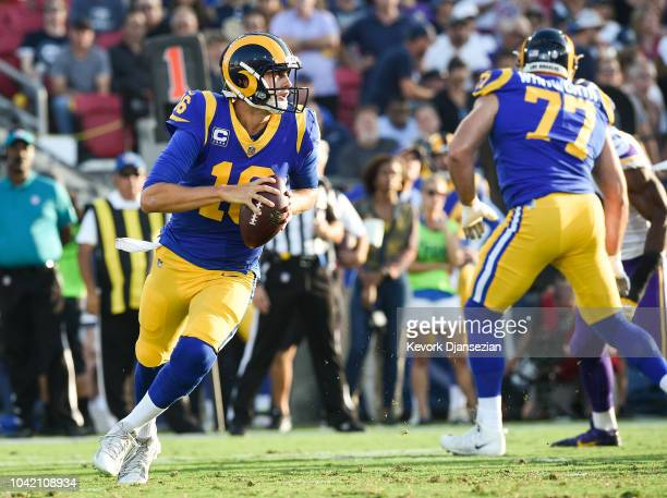 Quarterback Jared Goff of the Los Angeles Rams rushes out of the pocket against the Minnesota Vikings at Los Angeles Memorial Coliseum on September...