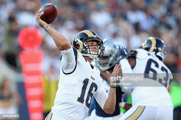 Quarterback Jared Goff of the Los Angeles Rams throws a pass against the Dallas Cowboys at the Los Angeles Coliseum during preseason on August 13...