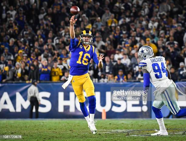 Quarterback Jared Goff of the Los Angeles Rams throws a pass to wide receiver Robert Woods in the fourth quarter against the Dallas Cowboys in the...