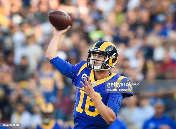 Quarterback Jared Goff of the Los Angeles Rams throws for a first down against the Minnesota Vikings at Los Angeles Memorial Coliseum on September 27...