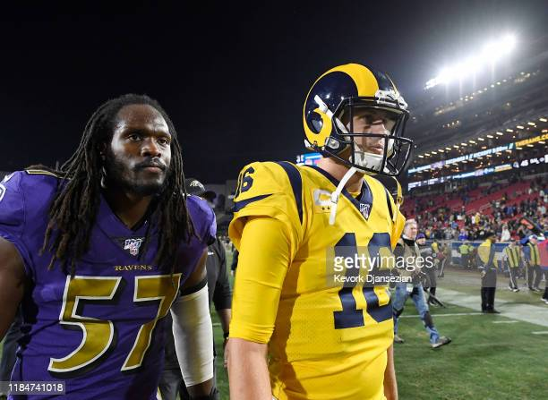 Quarterback Jared Goff of the Los Angeles Rams walks off the field followed Josh Bynes of the Baltimore Ravens after losing, 45-6, at Los Angeles...