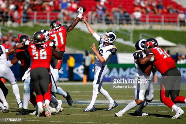 Quarterback Jared Goff's of the Los Angeles Rams pass is blocked by free safety Jordan Whitehead of the Tampa Bay Buccaneers during the fourth...
