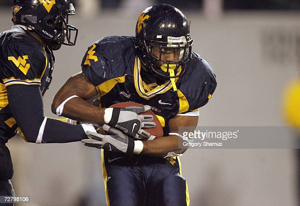 Quarterback Jarrett Brown the Virginia Mountaineers hands off the ball to Steve Slaton during the game against the Rutgers Scarlet Knights at Milan...