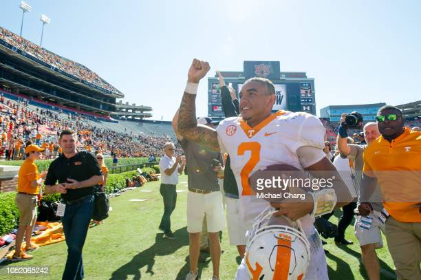 Quarterback Jarrett Guarantano of the Tennessee Volunteers celebrates after defeating the Auburn Tigers at JordanHare Stadium on October 13 2018 in...