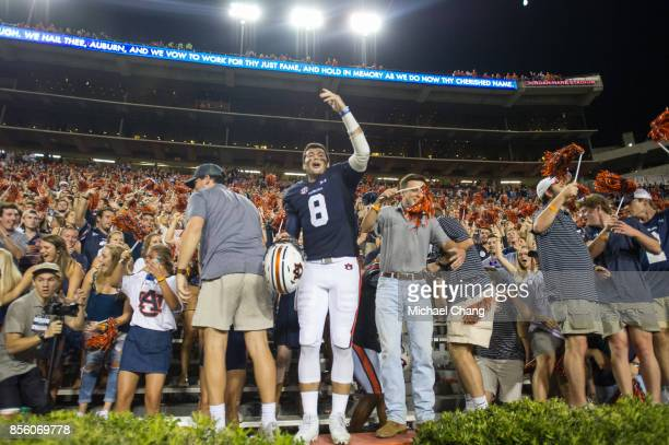 Quarterback Jarrett Stidham of the Auburn Tigers celebrates with fans after defeating the Mississippi State Bulldogs at JordanHare Stadium on...