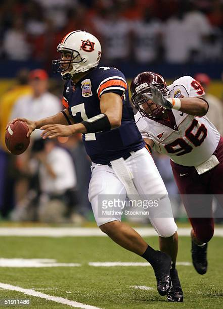Quarterback Jason Campbell of the Auburn Tigers is pressured by Noland Burchette of the Virginia Tech Hokies during the Nokia Sugar Bowl on January 3...
