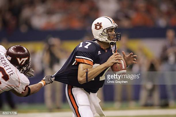 Quarterback Jason Campbell of the Auburn Tigers looks to pass while under pressure from defensive end Noland Burchette of the Virginia Tech Hokies...