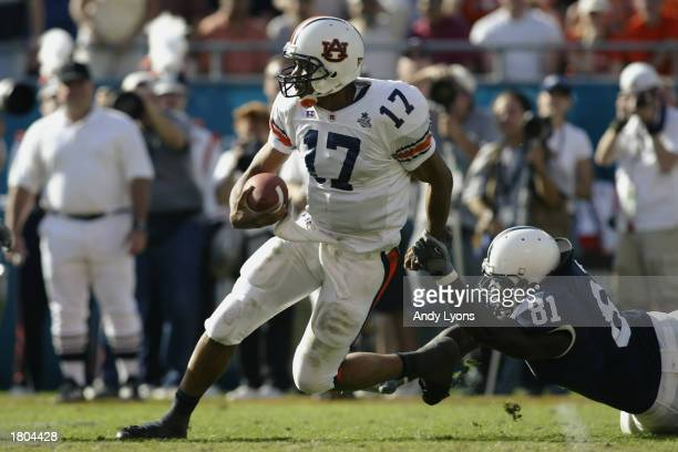 Quarterback Jason Campbell of the Auburn University Tigers scrambles against the Pennsylvania State University Lions during the Capital One Bowl at...