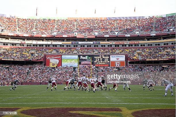 Quarterback Jason Campbell of the Washington Redskins hands the ball to runningback Ladell Betts in the fourth quarter of a game on November 26 2006...