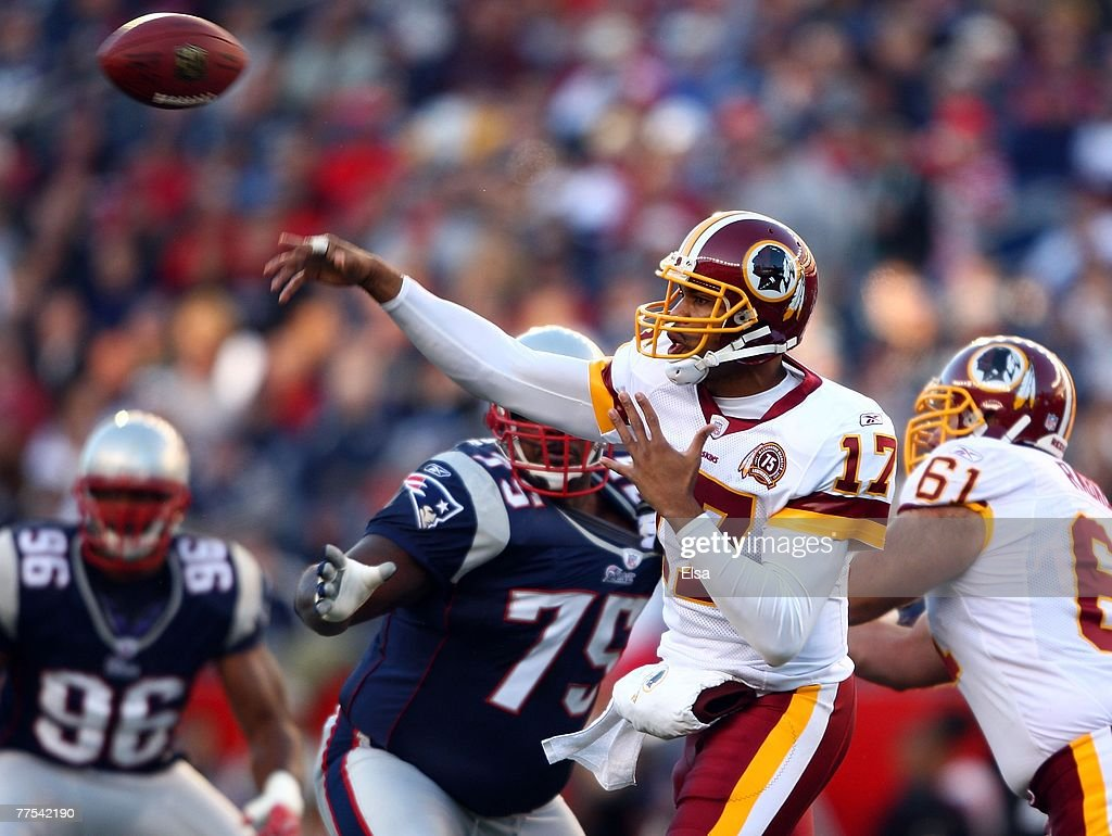 Quarterback Jason Campbell #17 of the Washington Redskins passes under pressure from Vince Wilfork #75 of the New England Patriots at Gillette Stadium October 28, 2007 in Foxboro, Massachusetts.