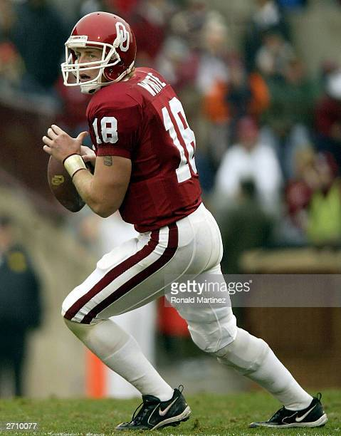Quarterback Jason White of the Oklahoma Sooners drops back to pass against the Texas AM Aggies at Oklahoma Memorial Stadium on November 8 2003 in...